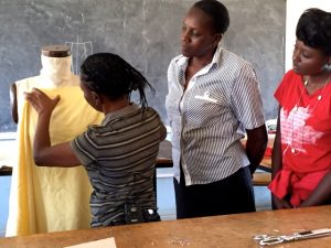 Sharon the teacher is demonstrating to her students how to drape a simple dress